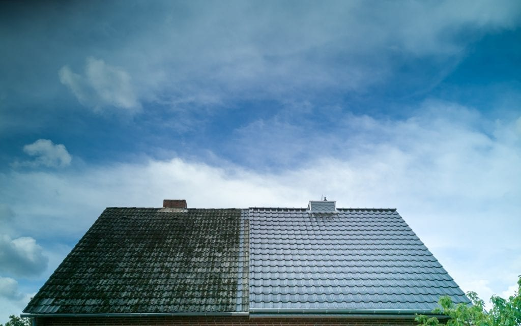 Before and after of a stained roof with dark streaks vs. a new, cleaned roof